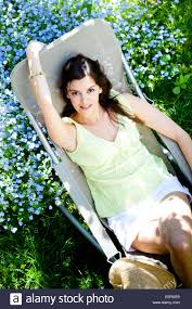 Chair In Garden Woman Relaxing On Chair In Garden Stock Photo Royalty Free Image