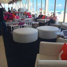 event furniture rental miami lounge seating with pillows and umbrellas evian ronen
