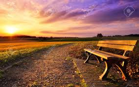 scenery images Colorful sunset scenery in rural landscape with a bench and a jpg