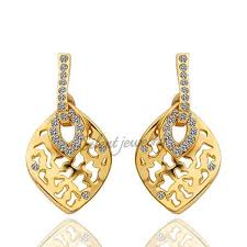 design of gold earrings ear tops free shipping leaf shaped gold ear tops designs for