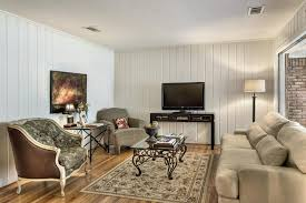 tongue and groove walls painted white make for a very cozy living
