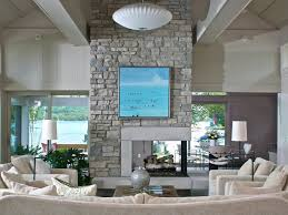 Gray Paneling by Spectacular Staircase In Fireplace Side Living Room Beige Tile