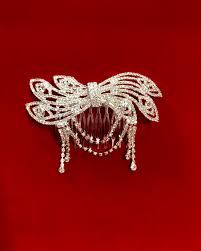 silver toned small bow comb with dangling rhinestone designs 4u