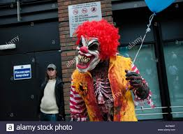 clown baloons a clown holding balloons in central london stock photo