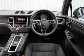 porsche macan 2016 interior jaguar f pace vs porsche macan luxury suvs compared hell