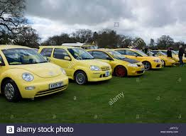 yellow volkswagen beetle royalty free bibury yellow car convoy stock photo royalty free image