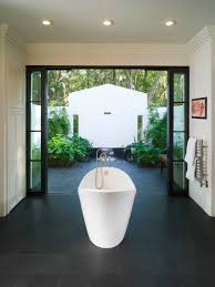 white soaking standing tubs under rectangular white ceiling with