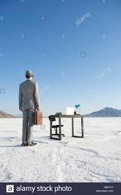 mobile office desk businessman arriving for work at mobile office desk outdoors on