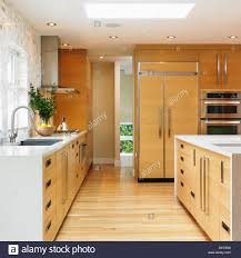 modern galley kitchen with edge grain oak cabinets victoria stock