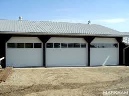 white door garage with black border and has glasses of window in