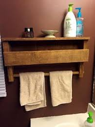 make a coat rack with shelves out of a pallet and some old door
