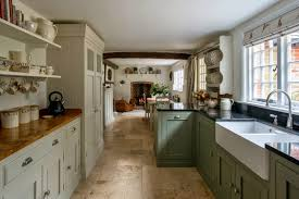 Farm House Designs by Wood And Stone Kitchen With Gourmet Range And Large Island With