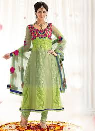 buy pleasing pista green net churidar suit online