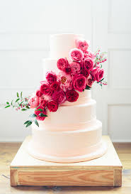 wedding cake flower white and pink cake with cascading flowers a wedding cake