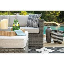 outdoor sectional set with ottoman by signature design by