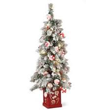 small artificial christmas tree with pine cones artificial trees