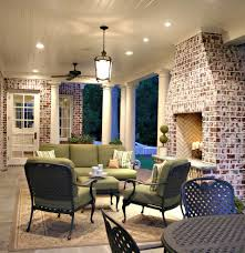 Outdoor Fireplace Surround by Beige Brick House Porch Traditional With Outdoor Cushions Brick