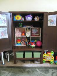book shelves and decorative boxes are attractive kids room storage
