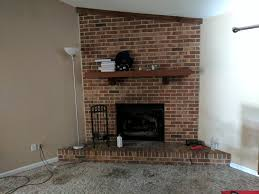 need help and ideas with giant red brick fireplace in living room