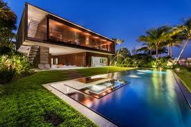a luxury miami beach home with pools natural lagoons and a