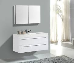 floating vanity and rectangle white single sink above brown wooden