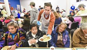 volunteers serve and deliver hundreds of thanksgiving meals at