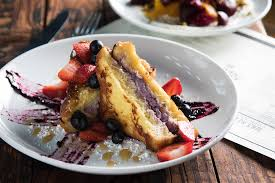 review the granary offers rich dense food en masse click to enlarge french toast is loaded with blueberries strawberries strawberry cream cheese lemon curd