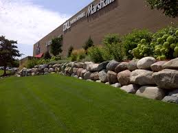 retaining walls natural stone vs blocks kg landscape management