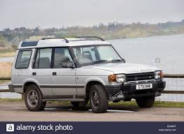 land rover discovery silver land rover discovery 2 4x4 car parked at the side of a