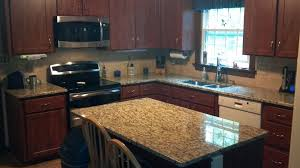 kitchen color ideas with light wood cabinets granite countertop working table cemetery flower vase granite
