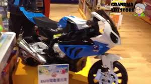 toys r us motocross bikes unboxing toys review demos bmw electric toy motorcycle for big
