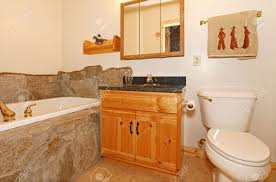 cowboy bathroom with rocks around tub stock photo picture and