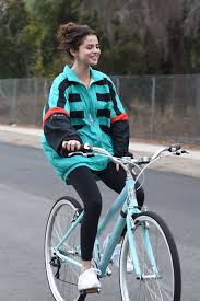 selena gomez cozies up to justin bieber after riding bikes see