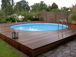 above ground swimming pool with low wooden deck three types of