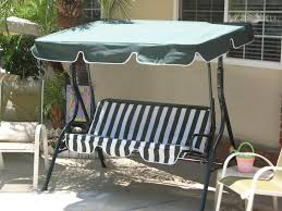Glider Swings With Canopy by Furniture Patio Glider With Canopy Completed By Bedding Cushion