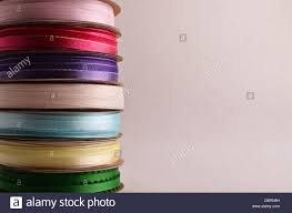 spools of ribbon a stack of spools of ribbon on a white background stock photo