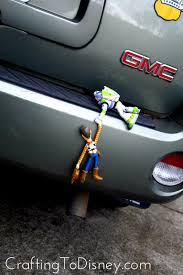 woody buzz bumper ornament on the hunt