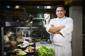 kitchen chef bittersweet bistro asian chef smiling at camera in restaurant