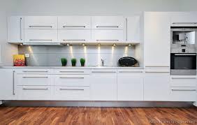white kitchen cabinets design white lights big pulls modern white kitchen