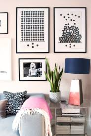 how make cheap frames look top notch how make cheap frames look top notch monochrome gallery wall