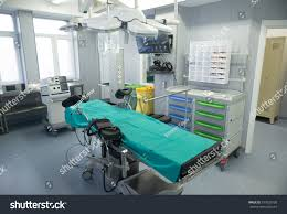 surgery room operation bed modern equipment stock photo 377023738