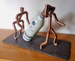 copperman quirky wine bottle holder by copper illuminate copper