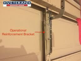 garage door bottom bracket metal piece broke on garage door section can i fix it