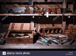 a nineteenth xix century 1800s work bench with saws planers