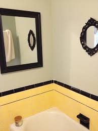 vintage yellow tile bathroom black tile and to reflect black and