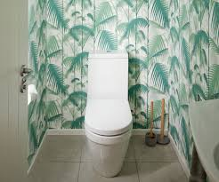 statement wallpaper helped to make this cold bach bathroom pop