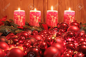 burning advent candles and ornaments as a