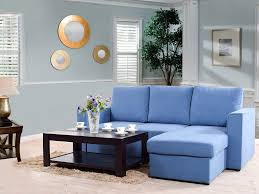 kowloon sectional sofa bed in blue color by urban ladder