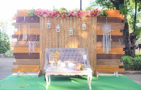 wedding backdrop setup rustic setup wooden backdrop grass mat tufted coffee