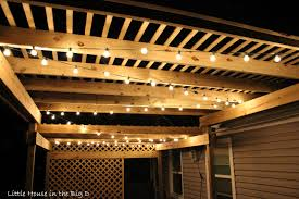 Hanging String Lights by Little House In The Big D Setting The Mood With Patio Lights